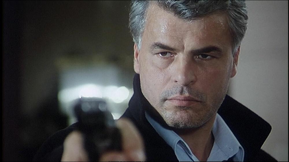 "Микеле Плачидо в роли комиссар Каттани. Кадр из сериала ""Спрут"""